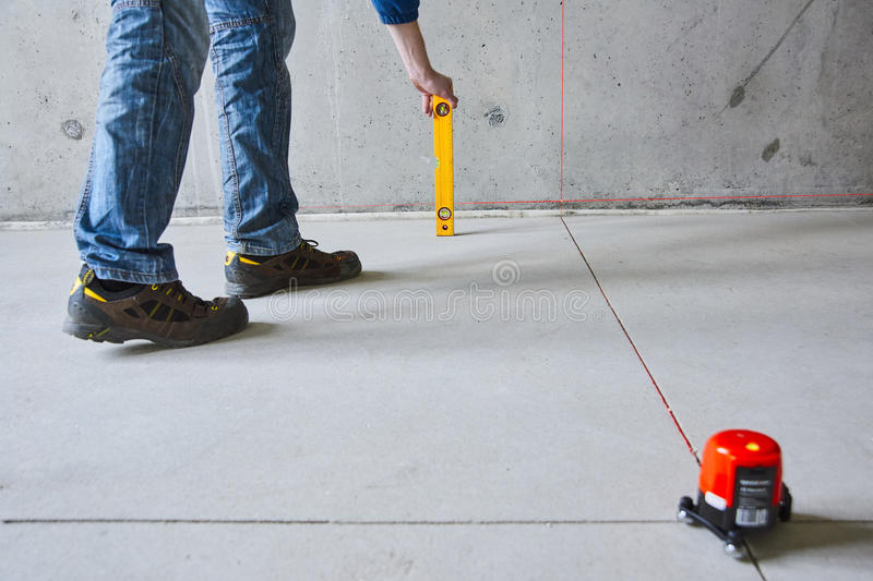 Man with laser level royalty free stock photos