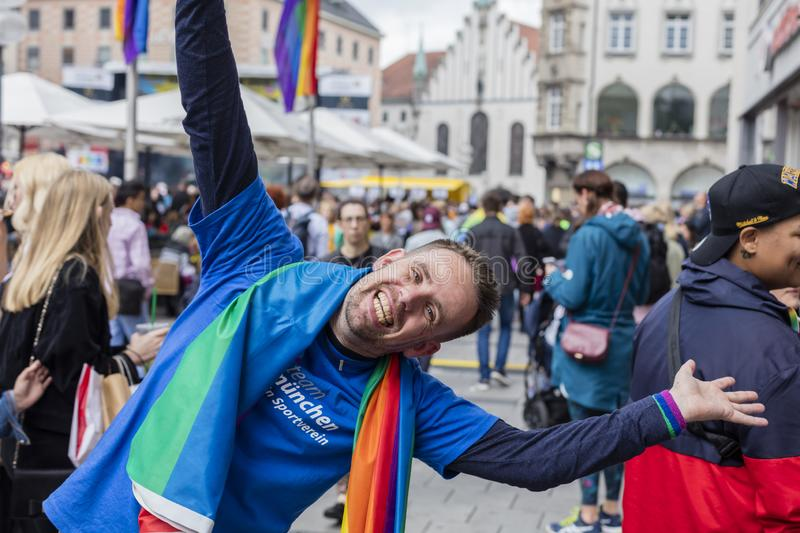A man laughing into the camera at the Marienplatz at the Christopher Street Day CSD in Munich, Germany. 2019: A man laughing into the camera at the Marienplatz royalty free stock photo