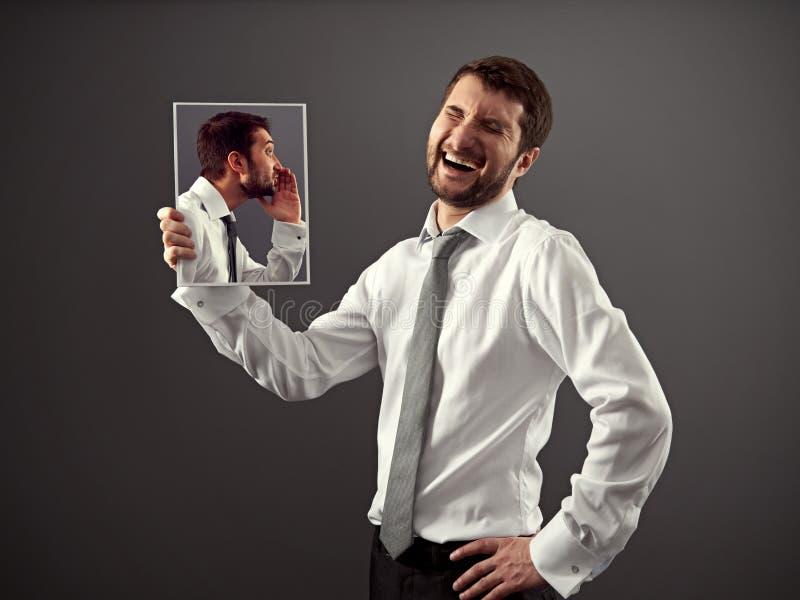 Man laughing at a joke stock photography
