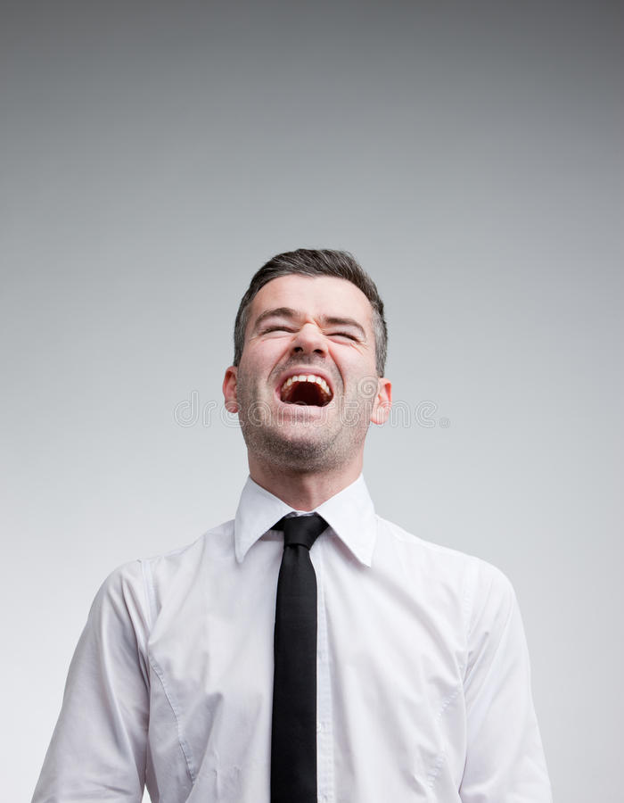 Man laughing out loud with a necktie royalty free stock photography