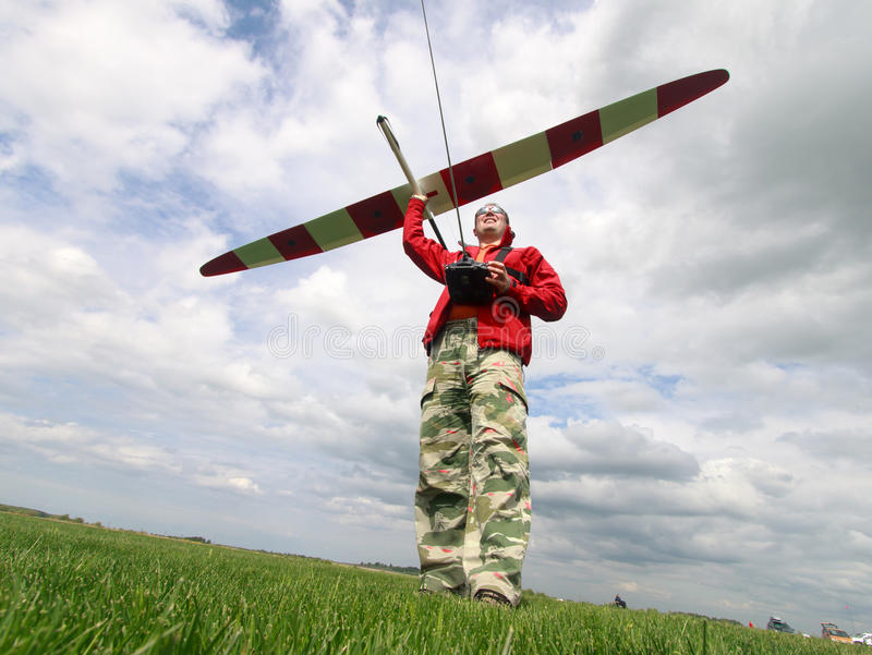 Man launches into the sky RC glider. Wide-angle royalty free stock photography