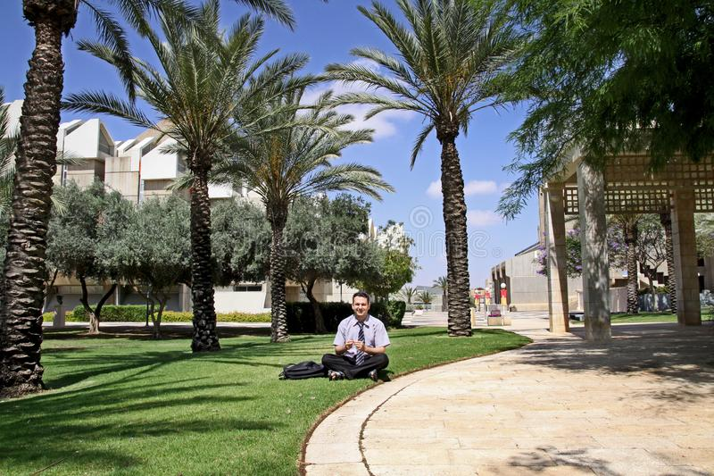 Man on the lawn in Ben Gurion University campus. In Beer Sheva royalty free stock photography