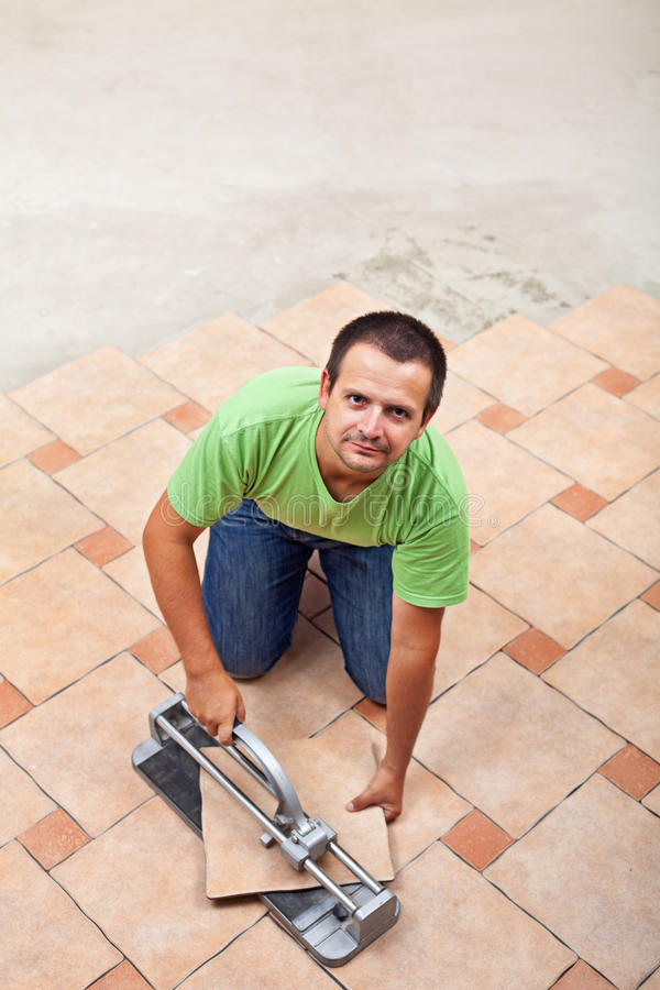 Man Laying Floor Tiles - With Copy Space Royalty Free Stock Photo