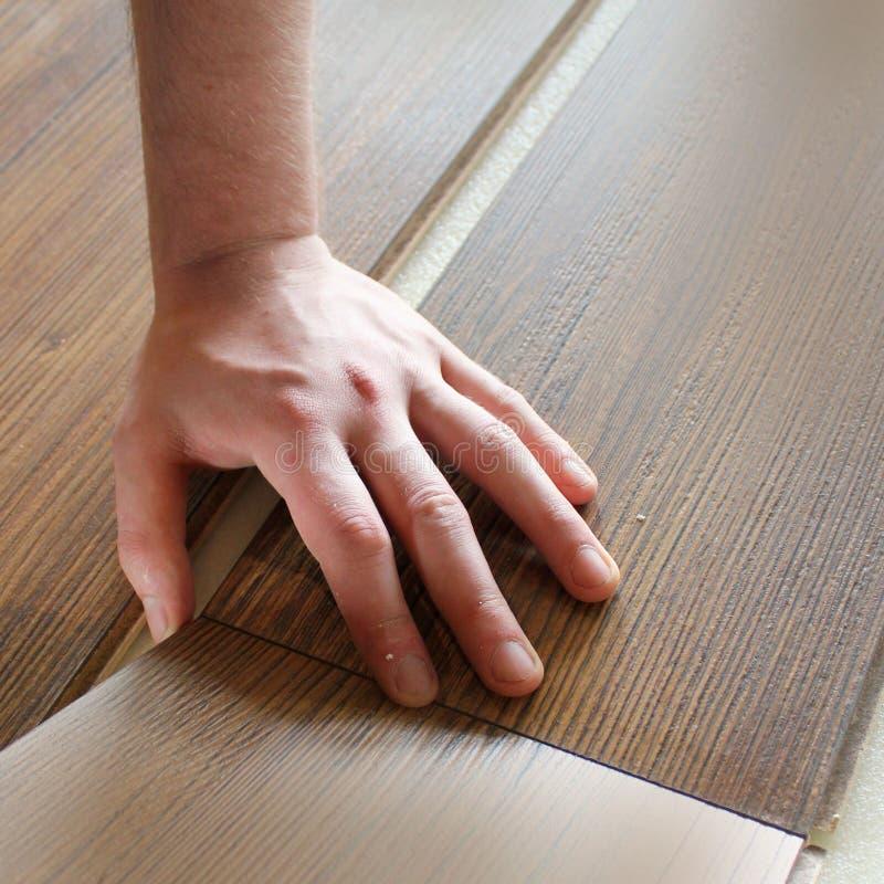 Man laying laminate flooring royalty free stock images