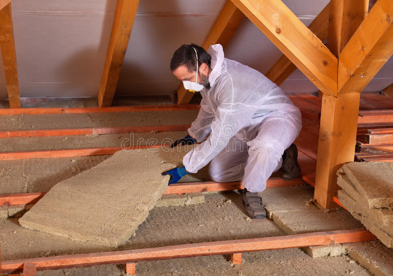 Man laying thermal insulation royalty free stock image