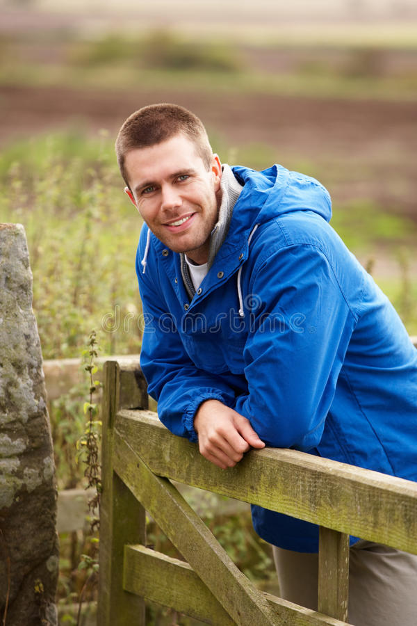 Man leaning on country gate royalty free stock photography
