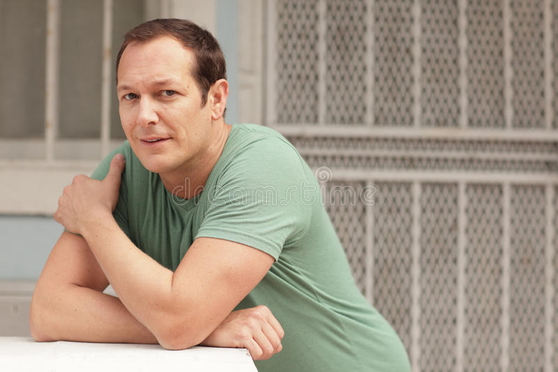 Download Man leaning on the ledge stock image. Image of hairline - 19262023