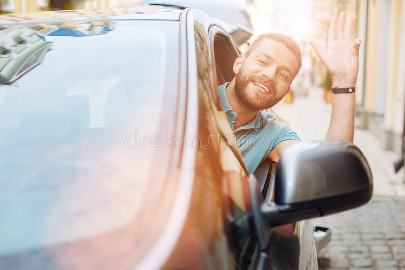Man leaning out of the car window and greeting someone stock image download man leaning out of the car window and greeting someone stock image image of m4hsunfo