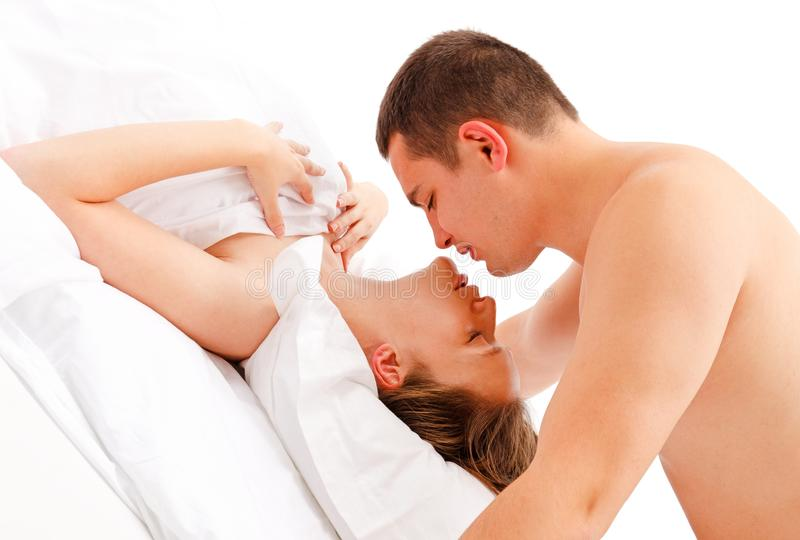 Man leaning over woman for a kiss stock photography