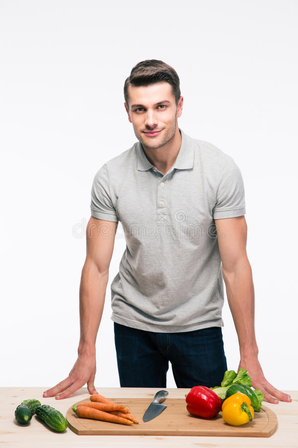 Man leaning on the table with vegetables stock photo
