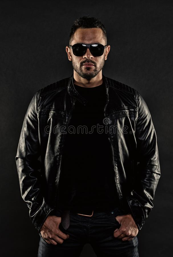 Man in leather jacket and jeans. Bearded man in trendy sunglasses. Fashion model in casual style clothes. Fashion and royalty free stock photos