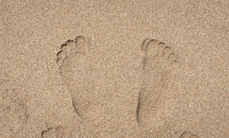 Man left footprints in the sand royalty free stock photo