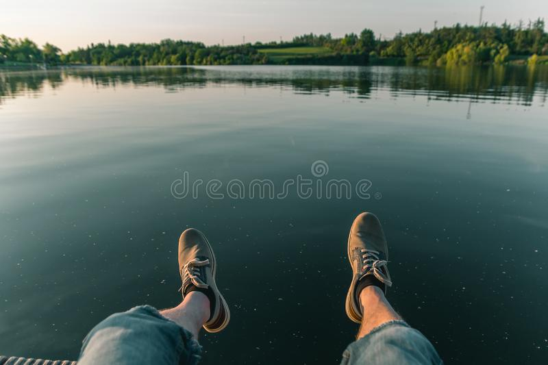 Man leg on pond Jordan at sunset in city Tabor, Czech republic.  stock photo
