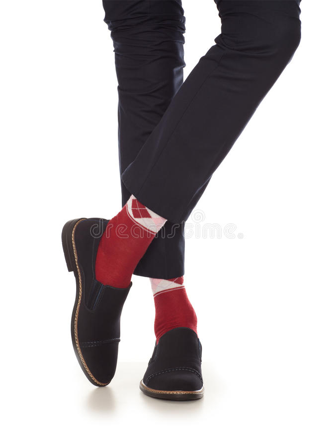 Man leg in red socks. Man leg in suit and red socks, isolated on white stock image