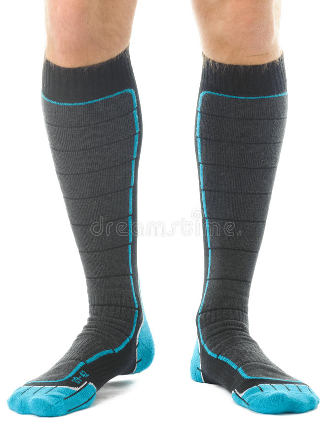 Man legs. In skis socks isolated on white royalty free stock photos