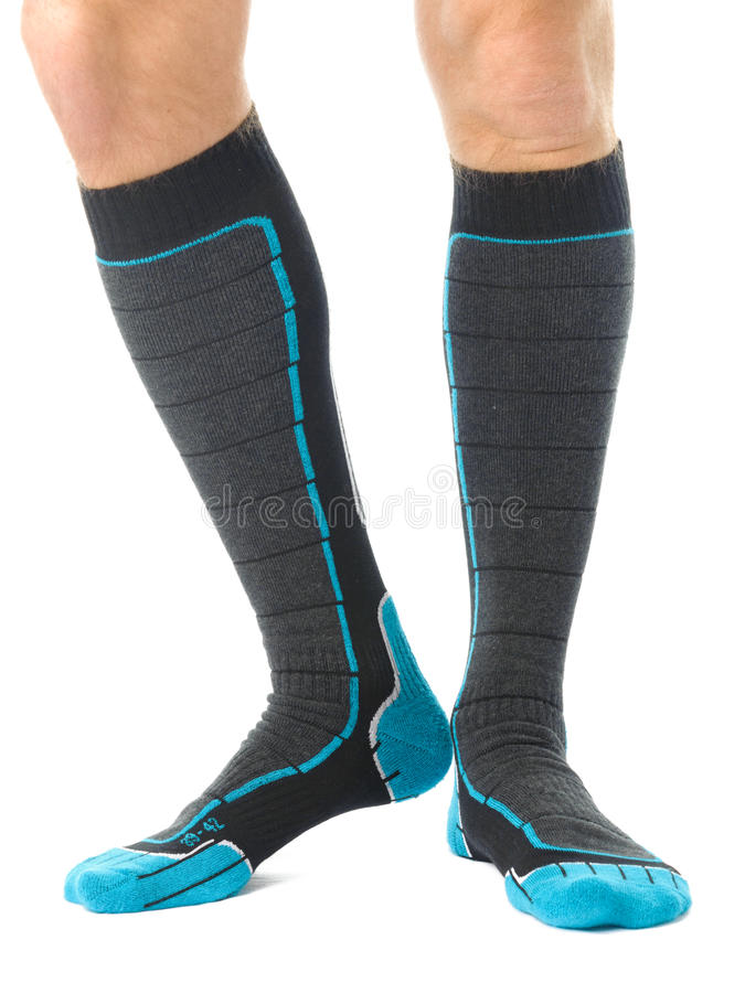 Man legs. In skis socks isolated on white stock photography