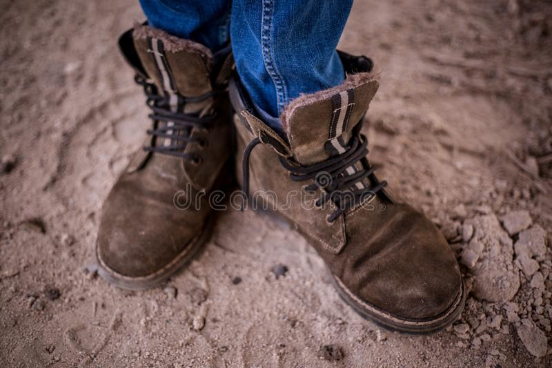 Man legs in old grunge shoes. Vintage filtre stock photography