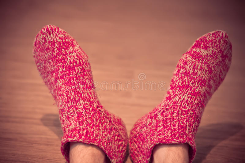 Man Legs in red Wool Socks male knitted clothes winter stock image