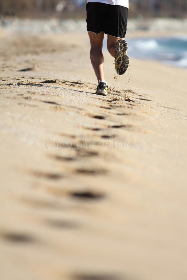 Download Man Legs Running On The Sand Of A Beach Stock Image - Image: 28385367