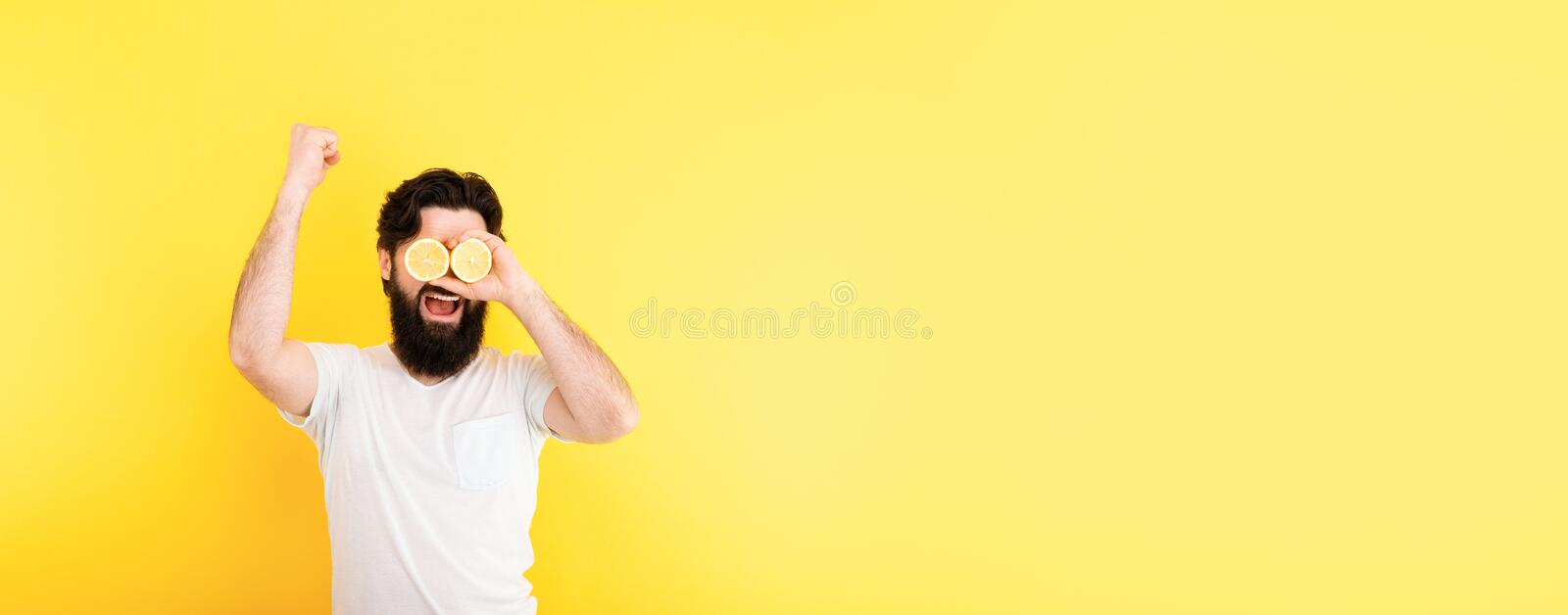 Man with lemon slices royalty free stock images