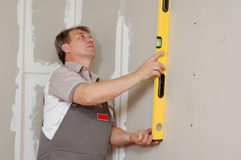 Man with level make renovation royalty free stock photo