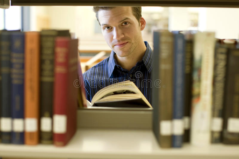 Download Man at library stock image. Image of human, handsome, color - 9608373