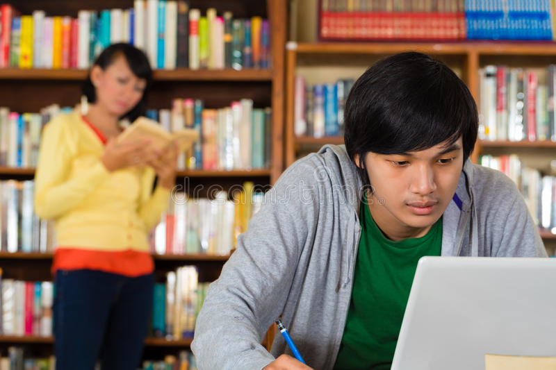 Download Man in library with laptop stock photo. Image of intelligent - 28735910