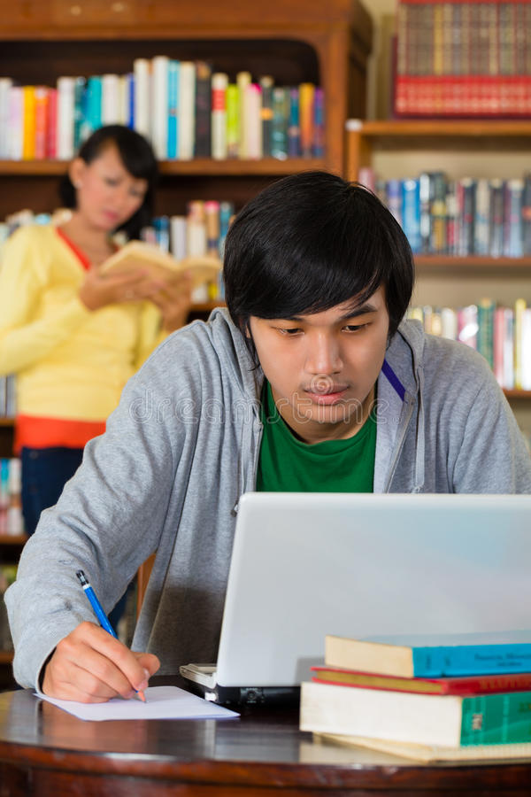 Man In Library With Laptop Stock Images