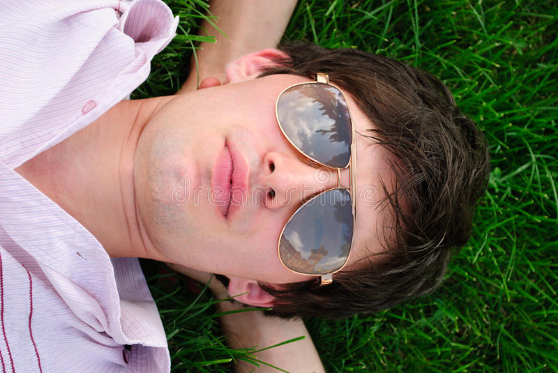 Download Man lie on the grass stock image. Image of look, lunch - 16748269