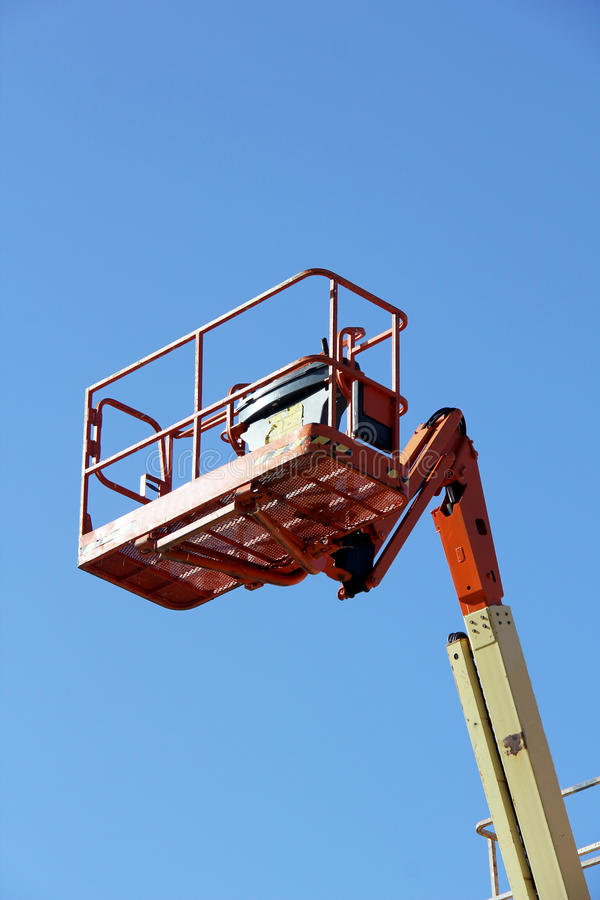 Man Lift. Cherry picker with a blue sky background royalty free stock photography
