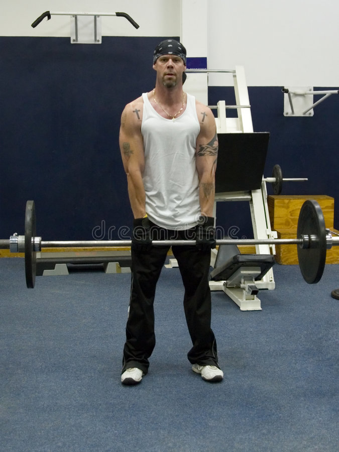 Download Man lifting barbell in gym stock photo. Image of adult - 1038754