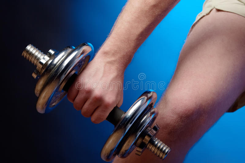 Download Man lifting a dumbbell stock photo. Image of person, sport - 10268058