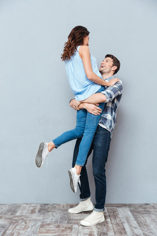 Man Lifting Up His Girlfriend Photos - Free & Royalty-Free Stock Photos  from Dreamstime