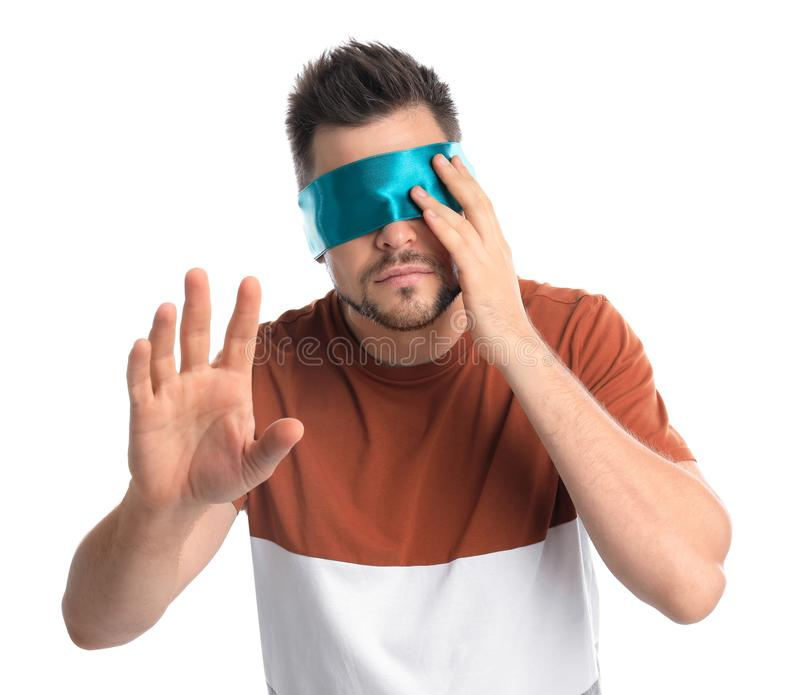 Man with light blue blindfold on white stock photos