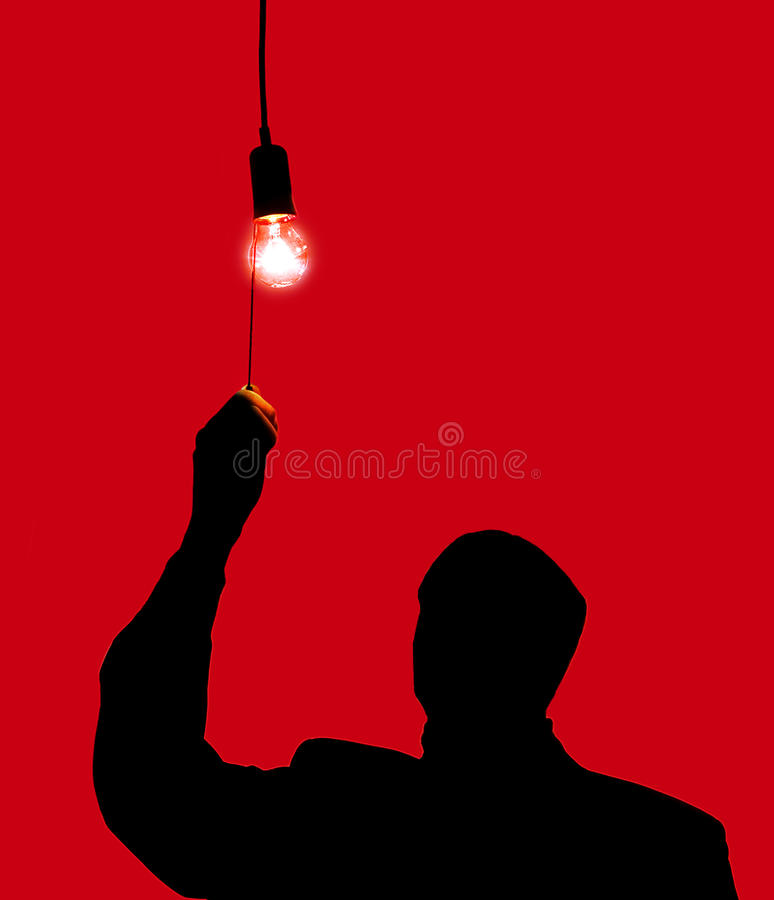 Man and a light bulb stock photography