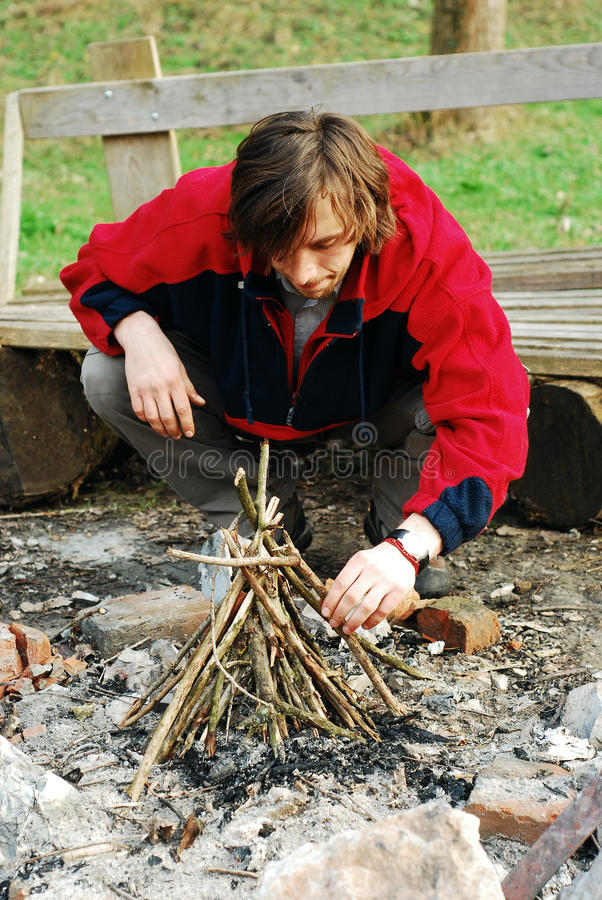 Download Man lighting fire stock photo. Image of outdoor, outdoors - 23030206