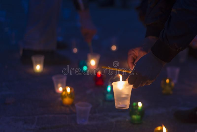 A man lights a candle. Day of Remembrance for the Bereaved royalty free stock image