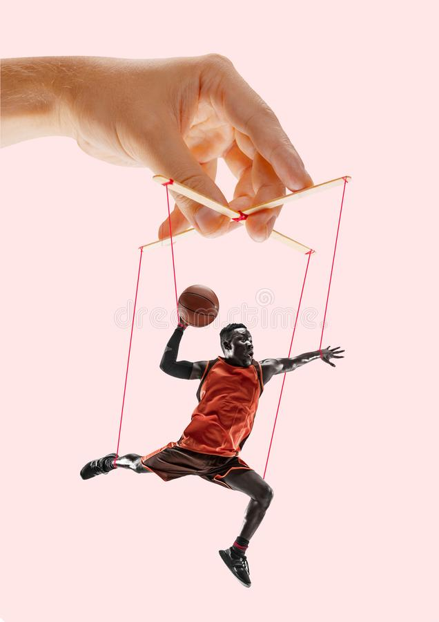 Man like a puppet in somebodies hands. Concept of manipulation stock images