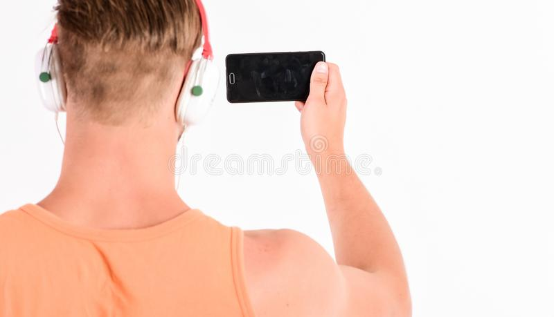 Man listen music headphones and smartphone white background. Modern technology. Music application concept. Enjoy perfect royalty free stock photo