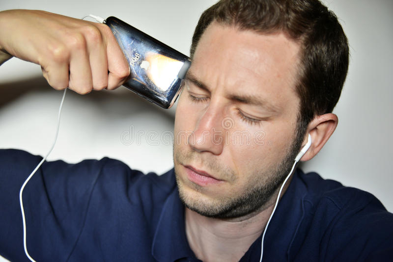 Download Man listening ipod editorial stock image. Image of young - 31629039
