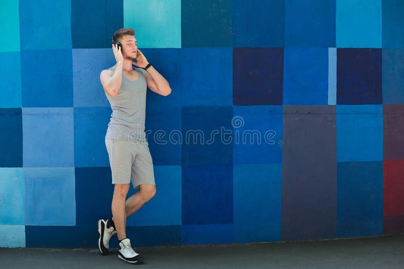 Man listening music outdoors, copy space royalty free stock photos