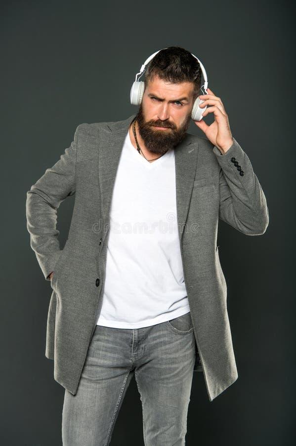 Man listening music wireless headphones. Hipster wear modern technology gadget headphones. Excellent sound. Music stock photos