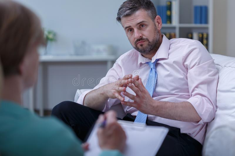 Man listening therapist advice stock photography