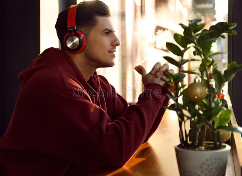 Man listening to audiobook at table in cafe royalty free stock photography