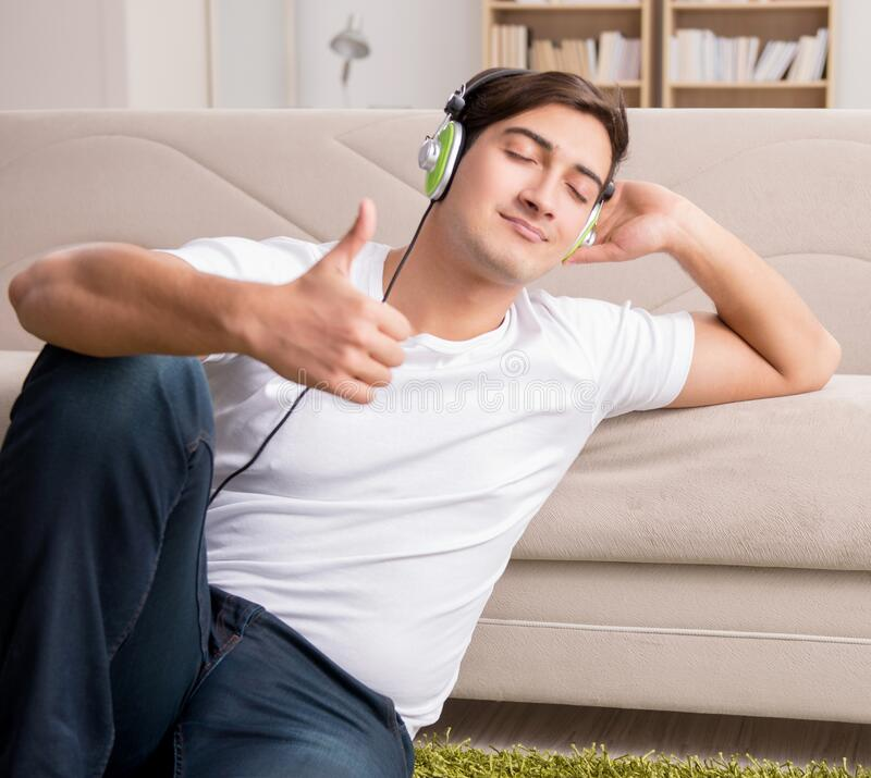 Man listening to music at home stock images