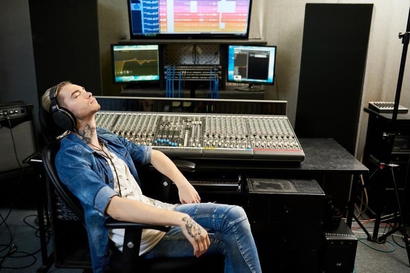 Man listening to music in studio royalty free stock photo