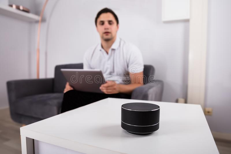 Man listening to music on wireless speaker royalty free stock photos