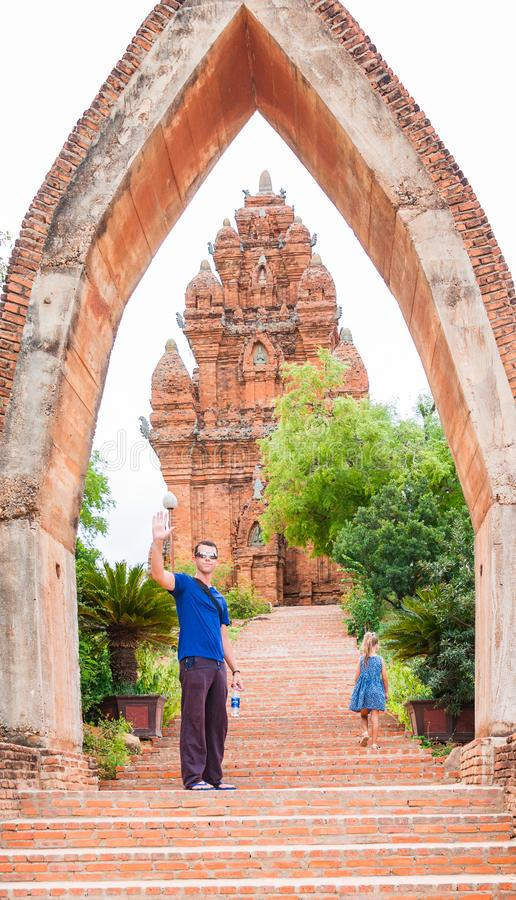 The man and little girl stand on the enter of Poklongarai champa tower. Located in Phan Rang, to the south of Nha Trang royalty free stock photo