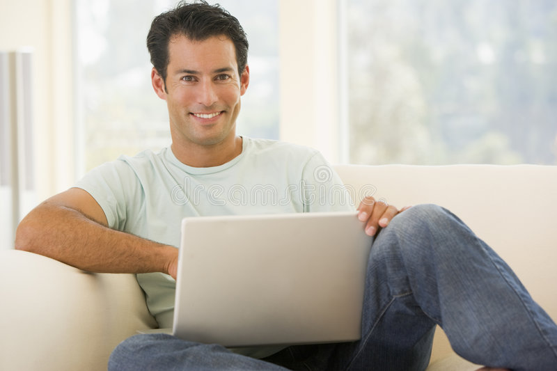 Download Man In Living Room Using Laptop Royalty Free Stock Photos - Image: 5927628