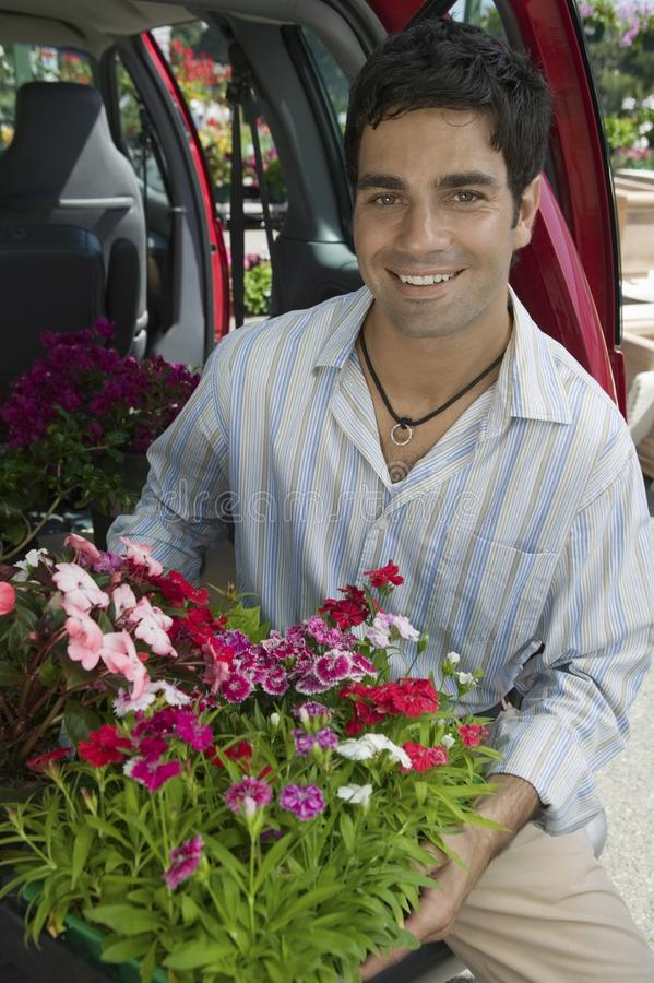 Man Loading Flowers into back of Van royalty free stock photos